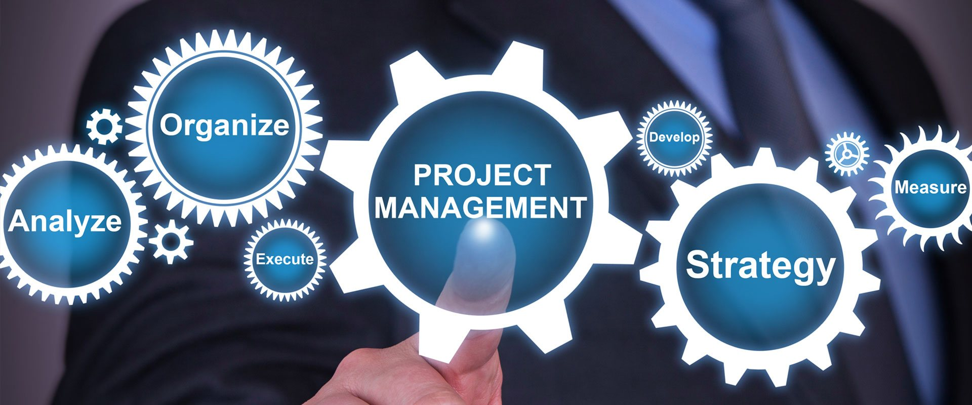 "A gear labeled ""Project Management"". For support REW Computing offers services in project management, as well as eDiscovery and IBM Lotus Notes support for Newmarket, Toronto, the GTA, and Ontario, Canada."